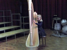 Rosie Gill playing harp